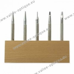 Set of punching tools on wood stand
