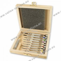 Set of screwdrivers and wrenches in wooden storage box